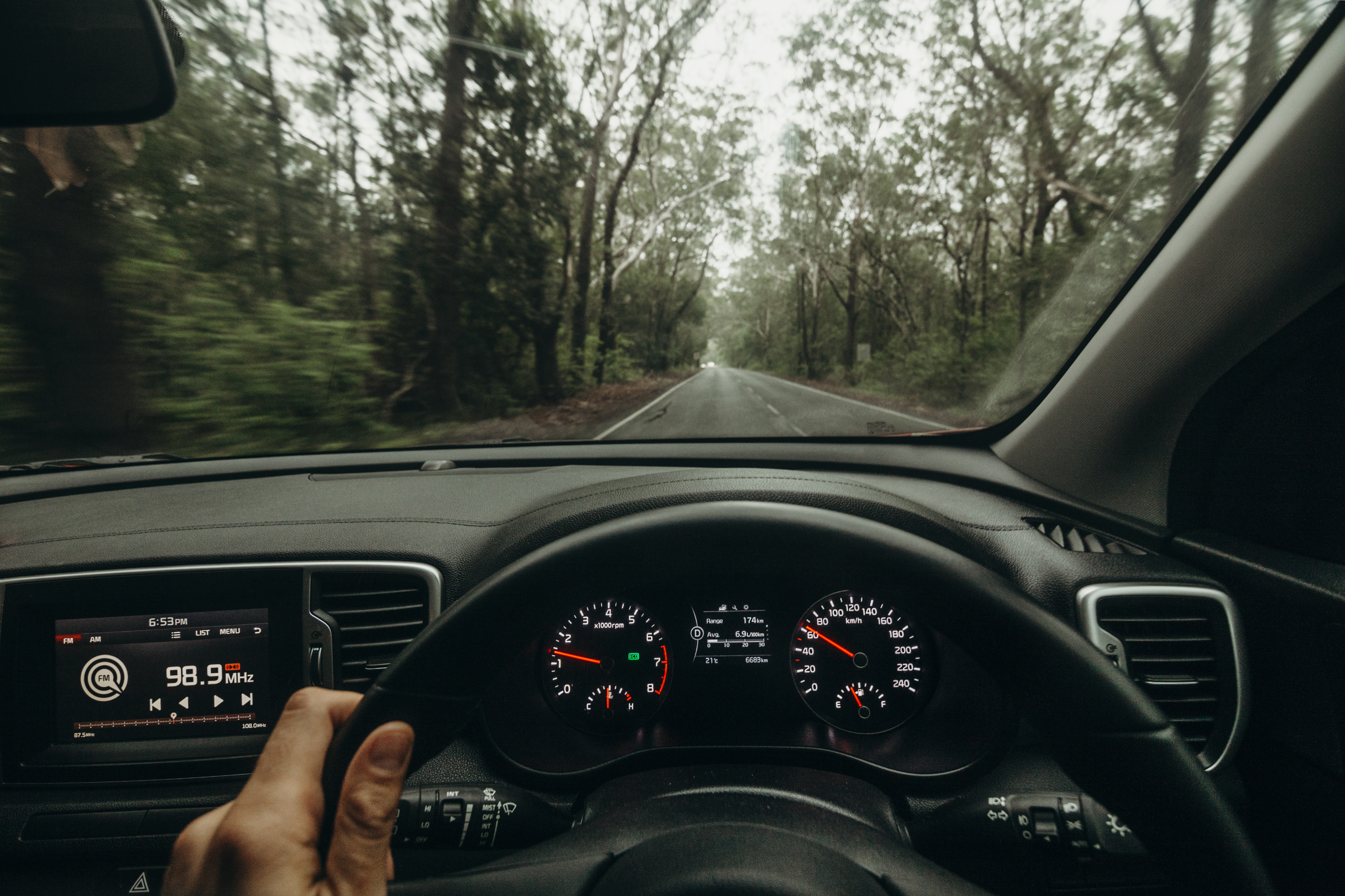 Inside view of car steering wheel while driving across Australia